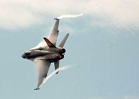 Les traînées d'avion, contrail  Sml_FA-18C_wingtip
